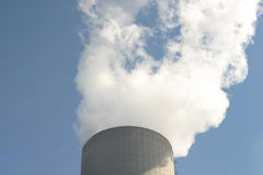 Power plant cooling tower. Top of a steam extruding cooling tower belonging to a coal fired power plant stock image