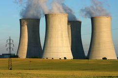 Power plant cooling towers in agriculture field Royalty Free Stock Image