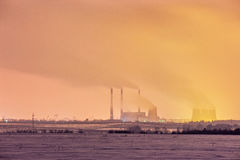 Power plant and cooling towers at dusk Royalty Free Stock Photos