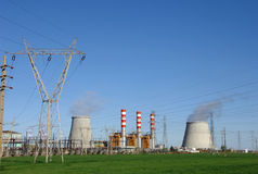 Power plant cooling towers emitting steam Stock Photos