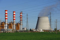 Power plant, cooling towers emitting steam Royalty Free Stock Image