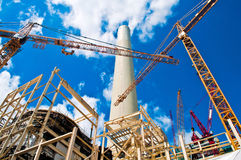 Power plant and cranes. Construction of a flue gas desulphurisation plant in a power plant stock images