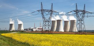 Power plant Dukovany with golden rapeseed field Stock Image