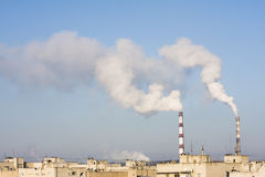 Power Plant emissions. Over the city stock photo