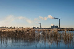 Power plant emissions in the middle of the city Royalty Free Stock Photo