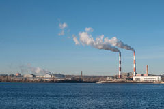 Power plant emissions in the middle of the city Stock Image