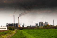 Power plant emitting dark black smoke Royalty Free Stock Photos