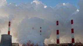 Power plant emitting smoke and vapor stock video