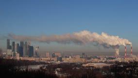 Power plant emitting smoke and vapor stock footage