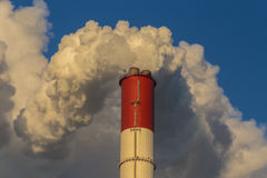 Power plant emitting smoke and vapor. In cold weather Royalty Free Stock Photography