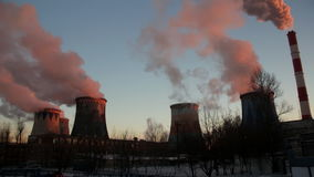Power plant emitting smoke and vapor in cold weather stock video footage
