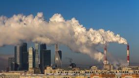 Power plant emitting smoke and vapor, time lapse stock video footage