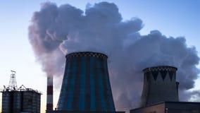 Power plant emitting smoke and vapor, time lapse stock footage