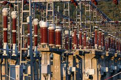 Power plant facility. Stack of Power plant facility poles royalty free stock photos