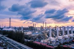 Power plant. Factory of oil and gas refinery industrial plant at evening, Manufacturing of petroleum industrial plant, Smoke stacks of power plant stock photo