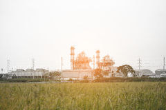 Power plant with the field. Royalty Free Stock Images