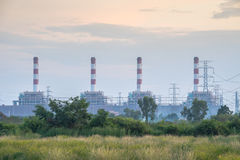 The power plant generate the electricity in the sunset sky Stock Photo