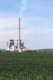 Power plant on green wheat field Stock Photo