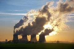 Power Plant - Greenhouse Gases - UK. Late afternoon sun through steam from the cooling towers and smoke from the chimney of a coal fired Power Station in Royalty Free Stock Photos
