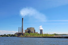 Power plant on Lake Michigan in Indiana. Coal- and gas-fired power plant of the Michigan City Generating Station and public beach on the shore of Lake Michigan royalty free stock photography