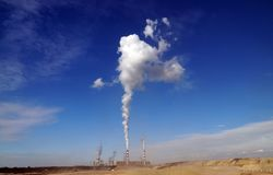 The power plant is located next to the opencast brown coal mine. stock image