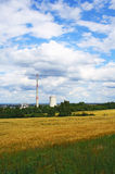 Power plant in nature. A power plant set in summer nature royalty free stock image