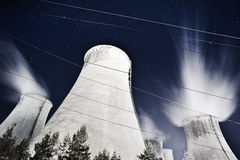 Power plant night. Huge power plant cooling towers with rising steam at night Royalty Free Stock Photo