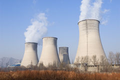 Power plant in northern china. Cooling towers of a electricity plant in norther china Stock Photo