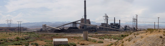 Power plant panorama. True wide panorama of a coal-burning power plant, complete with coal train, in the desert near Las Vegas, Nevada Royalty Free Stock Photo