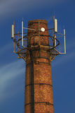 Power plant pipe with cellular aerials Stock Photos