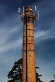 Power plant pipe with cellular aerials Royalty Free Stock Image