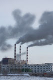 Power plant pollutes atmosphere Royalty Free Stock Image