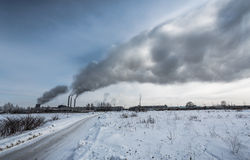 Power plant pollutes the environment Stock Images