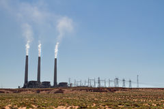 Power plant polluting air in desert Royalty Free Stock Images