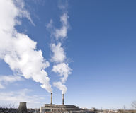 Power plant producing white smoke Royalty Free Stock Images