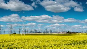 Power plant in a rapeseed field time lapse