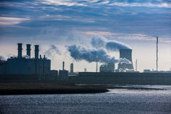 Power plant releasing green house fumes. /gases stock images