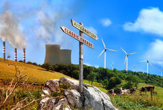 Power plant renewable vs factories classic with sign written Stock Photos