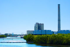 Power plant on a river Stock Photography