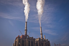 Power plant in a Romanian town. Pollution in a Romanian town from a coal power plant Stock Photos