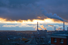 Power plant seen above residential blocks of city Royalty Free Stock Photography