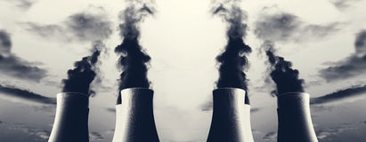 Power plant with several chimneys and huge fumes Stock Images