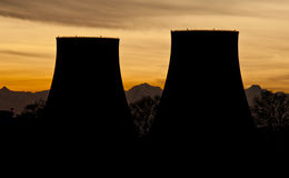 Power plant silhouettes. Against snowy mountains at sunset. Picture taken in Trino, Italy Stock Images