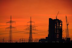 Power plant skyline. Power plant, power lines and wind turbines at sunset Stock Photography