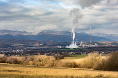 Power plant in Slovakia seen in distance surrounded by nature and small town Stock Photos