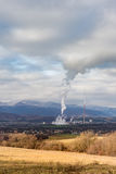 Power plant in Slovakia seen in distance surrounded by nature and small town Royalty Free Stock Images