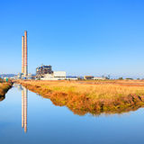 Power plant with smoke stacks and reflection Royalty Free Stock Images