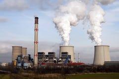 Power plant smokestacks smoke and the blue sky. Stock Images