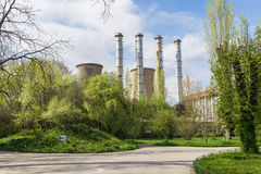 Power plant in spring green landscape Stock Images