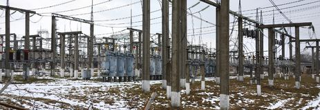 Power plant is a station of transformation. A lot of cables, pol. Es and wires, transformers. Electro-energy royalty free stock photos
